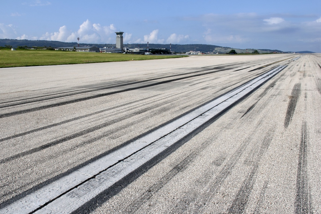 'Concrete runway of Split airport with traces of airplane wheels' - Split
